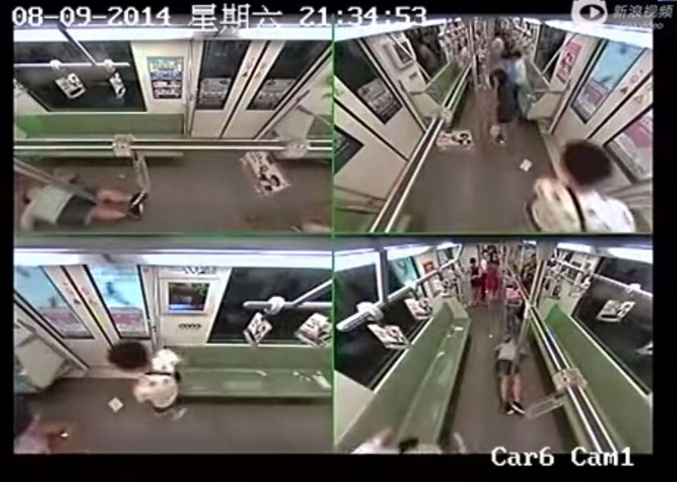 A still from the surveillance camera footage shows the fainting man (top left and bottom right) lying alone in a subway car, as the few remaining occupants hurry away. (YouTube)