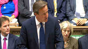 British Prime Minister David Cameron told the House of Commons on Monday that he wants to give police the power to seize the passports of Islamist fighters bound for Iraq and Syria.