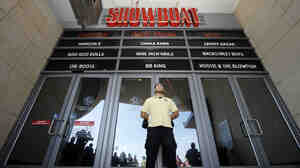 A security guard blocks entrance to the closing Showboat Casino Hotel on Sunday in Atlantic City, N.J.