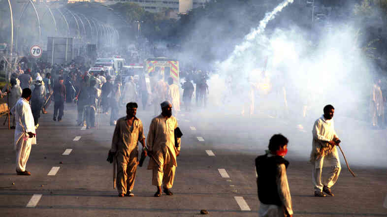 Police use tear gas to disperse protesters in Islamabad, Pakistan, on Monday.