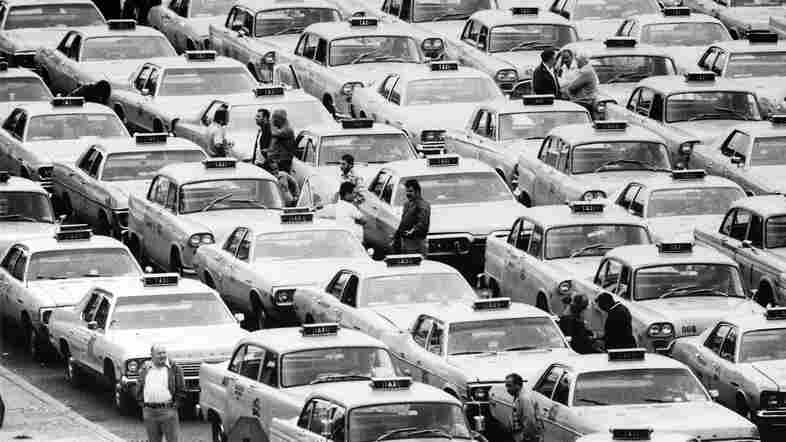 Taxi cabs wait in a holding area at New York's LaGuardia Airport in Queens in 1974. One of the interviews by oral historian Studs Terkel in the '70s was with Ohio cab driver Helen Moog.