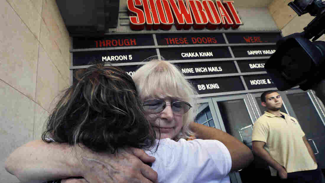 Long time employees Denise Miller, facing camera, and Gloria Panameno hug as they leave the Showboat Casino Hotel on Sunday. Owner Caesars Entertainment closed the still-profitable Showboat to reduce the number of casinos in Atlantic City, which has been struggling with plunging revenue.