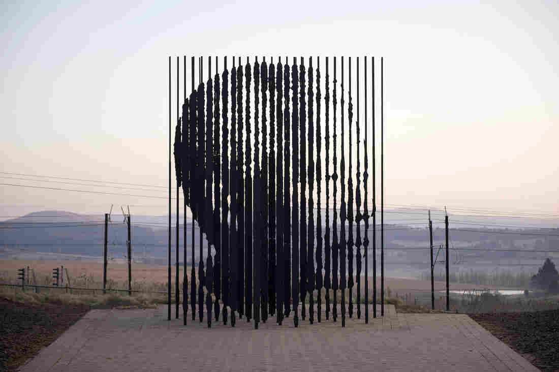 When the steel columns align they reveal the face of Nelson Mandela.