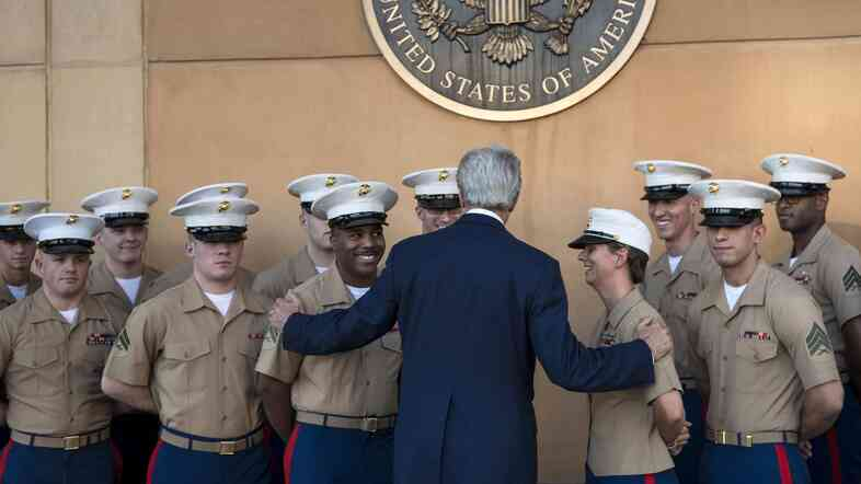 U.S. Secretary of State John Kerry greets U.S. Marines as he arrives June 23 at the American embassy in the International Zone in the Iraqi capital Baghdad.