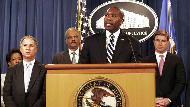 Associate Attorney General Tony West, at podium, speaks at the Justice Department in Washington on Aug. 21. West is preparing to announce he is leaving government for a job in the private sector.