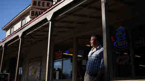 Randen Patterson left a research career in physiology at U.C. Davis when funding got too tight. He now owns a grocery store in Guinda, Calif.