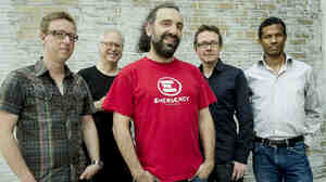 Stefano Bollani (center) and the musicians who back him on the new album Joy in Spite of Everything. From left: Mark Turner, Bill Frisell, Jesper Bodilsen, Morten Lund.
