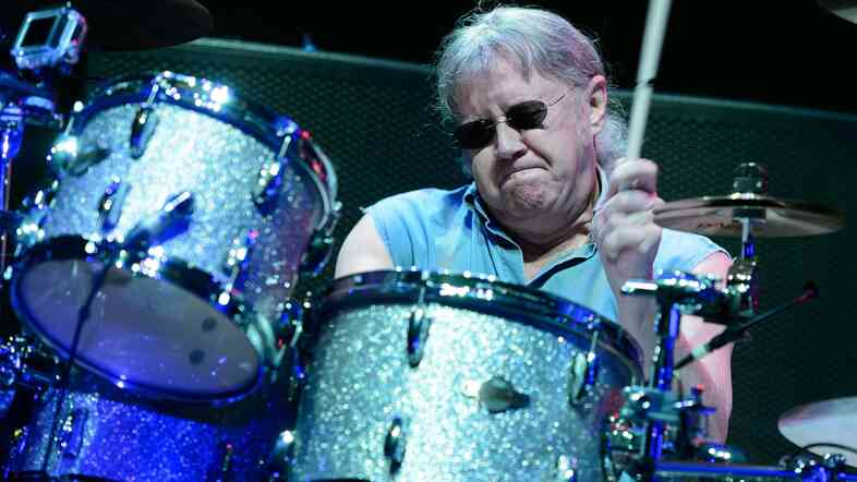 Drumming is hard work! Here's Ian Paice of the rock band Deep Purple getting it done in a performance earlier this year in Poland.