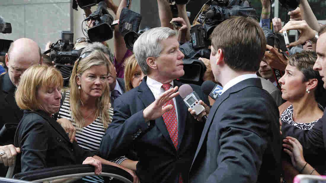 Former Virginia Gov. Bob McDonnell (center) is mobbed by med