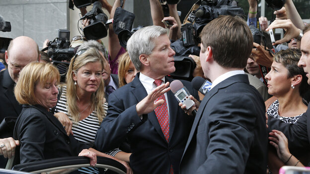 Former Virginia Gov. Bob McDonnell (center) is mobbed by media as he gets into a car with his son, Bobby (right), after he and his wife, former first lady Maureen McDonnell, were convicted of multiple counts of corruption Thursday in Richmond.
