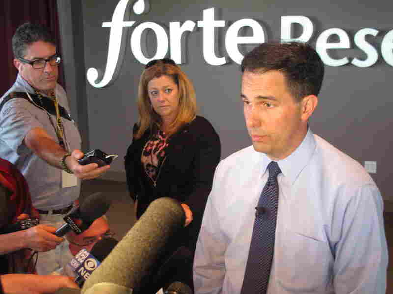 Gov. Scott Walker answers questions while celebrating the growth of local software company Forte Research Systems. He announced the company is adding 55 jobs with the help of a state loan.