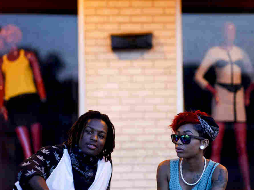 Asia Jackson (left) and Taylor Barnes sat in front of a West Florissant Avenue boutique on Aug. 20 in Ferguson, Mo. Both are from Ferguson and were out to support the protest.