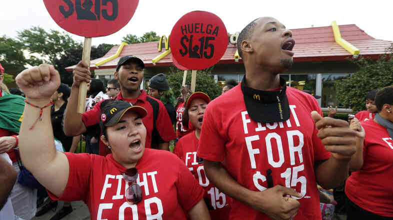 Protesters demonstrate outside a McDonald's in Chicago. Hundreds of workers from McDonald's, Taco Bell, Wendy's and other fast-food chains were expected to walk off their jobs Thursday to push the companies to pay their employees at least $15 an hour, according to labor organizers.