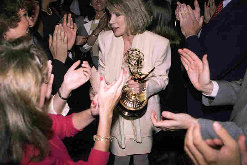 Fans congratulate Rivers after she won the Emmy for outstanding talk show host in 1990. Rivers, host of The Joan Rivers Show, dedicated her Emmy to her late husband.