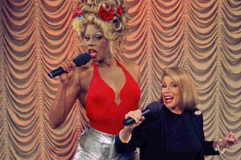 "RuPaul sings a number from his debut album ""Supermodel of the World"" with Rivers during taping of The Joan Rivers Show in 1993."