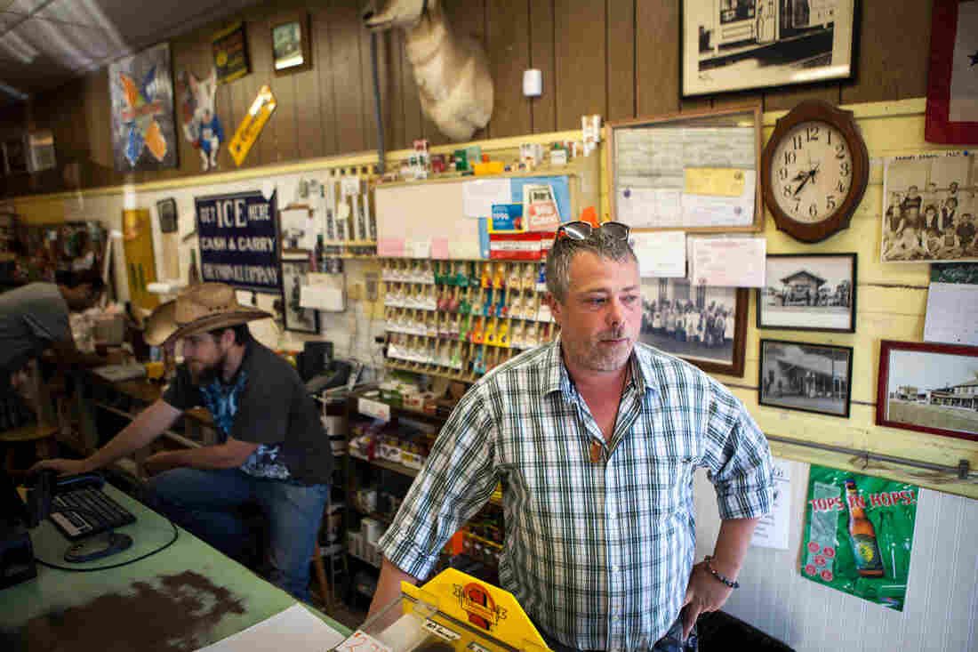Randen Patterson (right) mans the register at the Corner Store in Guinda.