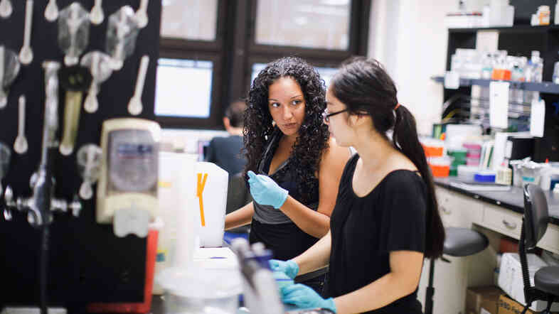 Victoria Ruiz (left), a postdoctoral fellow in immunology, works with Brianna Delgado, a high school student that she mentors, at the Blaser Lab, inside NYU's Langone Medical Center in New York, NY.