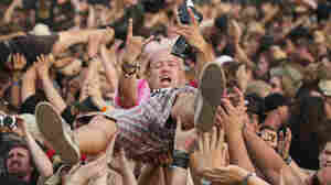 A fan crowd-surfs at the 2014 Wacken Open Air heavy metal music festival in Germany.