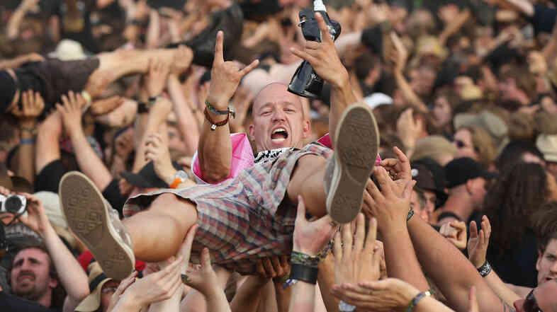 A fan crowd-surfs at the 2014 Wacken Open Air heavy metal music festival in Germany.