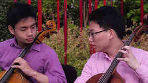 Teen cellists Jeremy Tai and Minku Lee playing at Chihuly Garden and Glass.