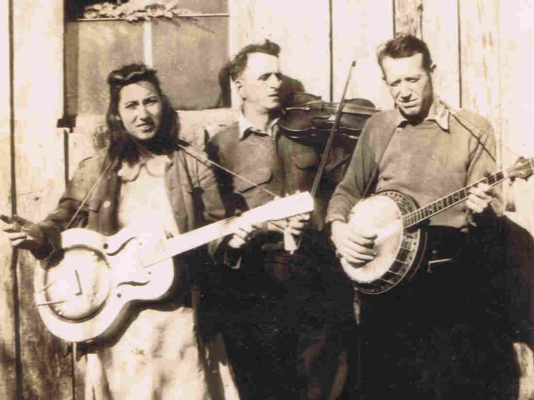 """""""Fiddlin' John"""" Sharp (center), seen here with daughter Evelyn and banjo player Red Morris, is among the many musicians whose stories and songs are documented in Bobby Fulcher's archive."""