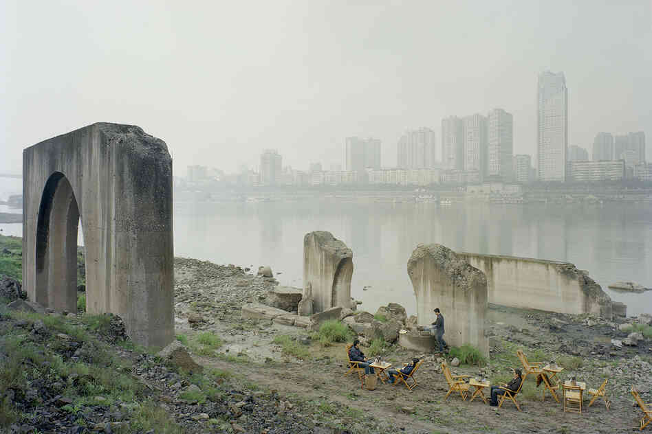 Zhang Kechun; Under the Abandoned Pier, 2013-2014. Zhang, 34, spent years shooting photos along the Yellow River. The figures are tea sellers.
