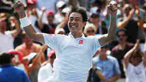 Kei Nishikori of Japan reacts after defeating Novak Djokovic of Serbia to reach the finals of the 2014 U.S. Open.