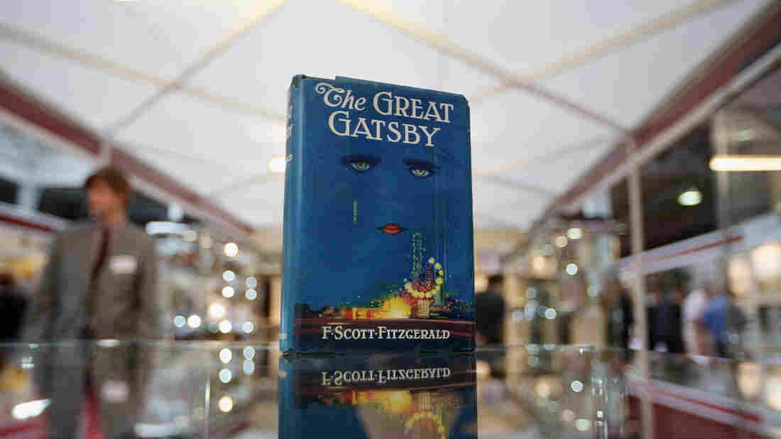 """A first edition of F. Scott Fitzgerald's The Great Gatsby was displayed at the London International Antiquarian Book Fair in 2013. Book critic Maureen Corrigan — who calls the cover """"striking"""" — says she likes to think that if it landed on her porch today among the more than 200 books she receives a week, she would read it."""