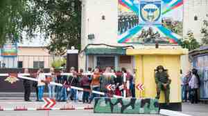 Mothers and wives of Russian paratroopers captured in Ukraine wait for information outside their base in Kostroma, Russia. Russia's military has been challenged to explain an upsurge in dead and missing soldiers from its elite units.