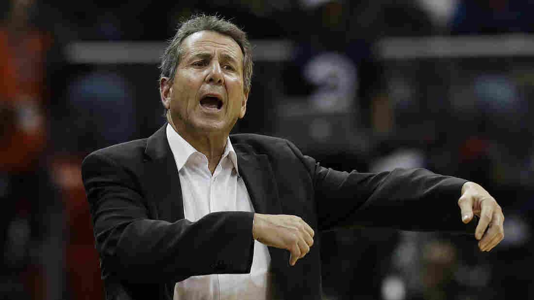 Bruce Levenson, seen at an Atlanta Hawks game on Dec. 4, 2013, in Atlanta, announced Sunday that he was selling his stake in the team because of a racially charged email he sent in 2012.