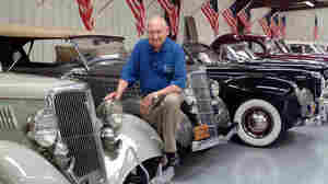 Chick-fil-A founder S. Truett Cathy, seen here with his classic car collection, died Monday at age 93.