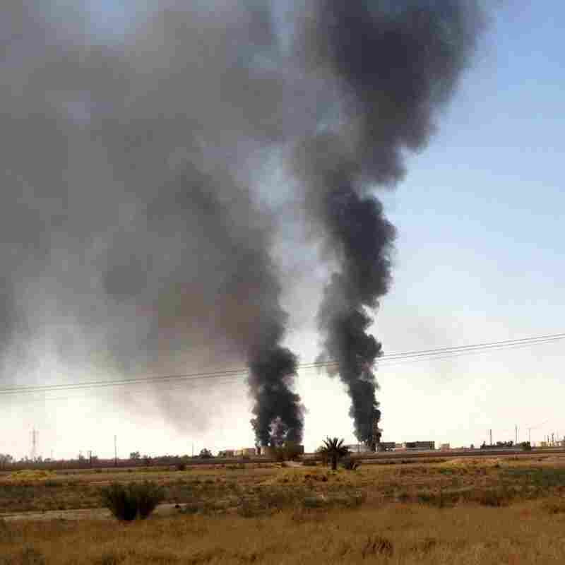 Smoke rises from the Beiji oil refinery during clashes between the Islamic State and Iraqi government forces in Beiji, northern Iraq, on July 30. The militants tried to take the refinery this summer, but government forces have held on.