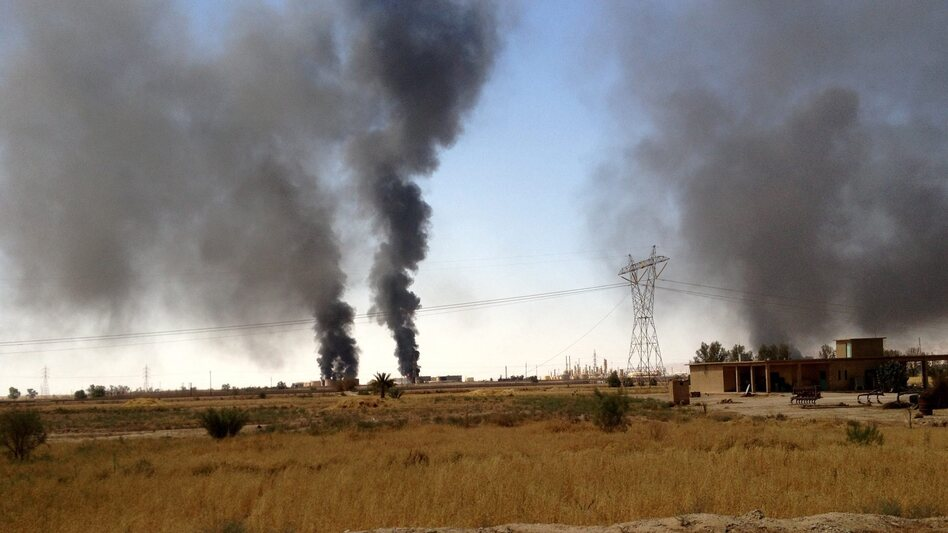 Smoke rises from the Beiji oil refinery during clashes between the Islamic State and Iraqi government forces in Beiji, northern Iraq, on July 30. The militants tried to take the refinery this summer, but government forces have held on. (STR/EPA/Landov)