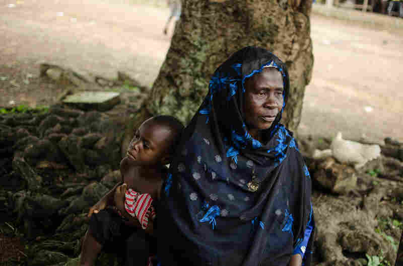 """Mamuedi Kanneh, president of the Barkedu women's association, has taken in the children of her niece, who died from Ebola. """"I'm worrying about them all the time,"""" she says."""