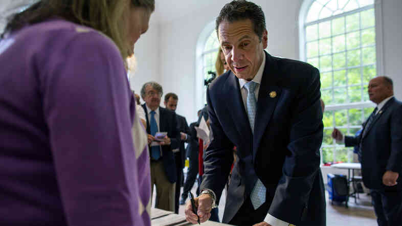 Gov. Andrew Cuomo signs in to cast his vote during the primary election Tuesday at the Presbyterian Church of Mount Kisco in Mount Kisco, N.Y.