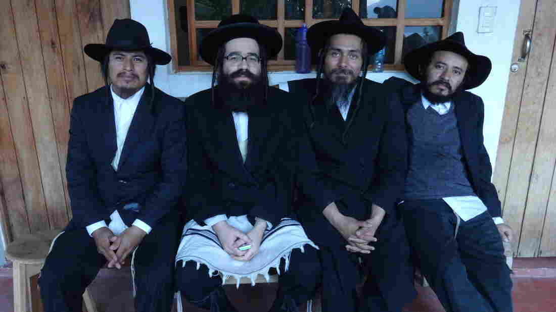 Some 150 members of the ultra-Orthodox Lev Tahor sect fled Canada earlier this year amid allegations that young women were forced to marry older men. They were recently asked to leave a village in Guatemala and are again searching for a home. Uriel Goldman (second from left) is the group's spokesman.