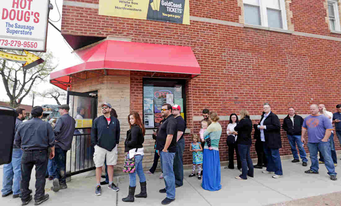 Aficionados line up outside Hot Doug's, a gourmet hot dog diner in Chicago, in May. Owner Doug Sohn has announced that he will shut the doors in October after nearly 14 years.