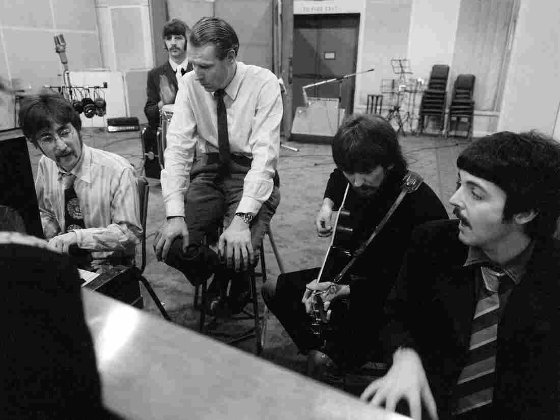 The Beatles with George Martin in January 1967 at Abbey Road Studios in London.
