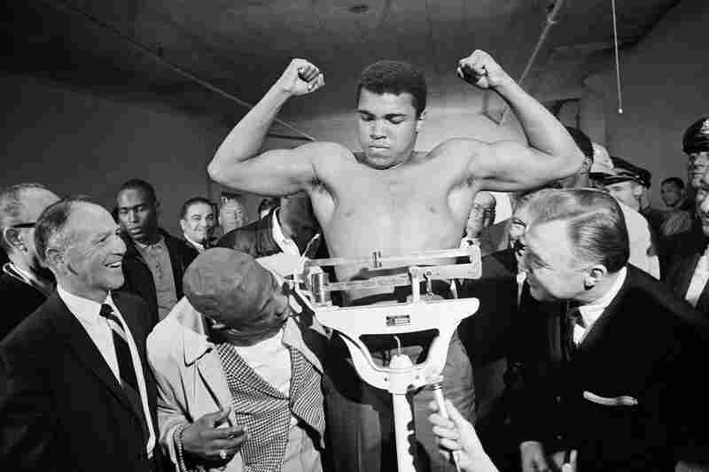 Boxer Muhammad Ali weighs in a week before his heavyweight bout with Jerry Quarry on Oct. 20, 1970 in Atlanta. Ali died at XX.