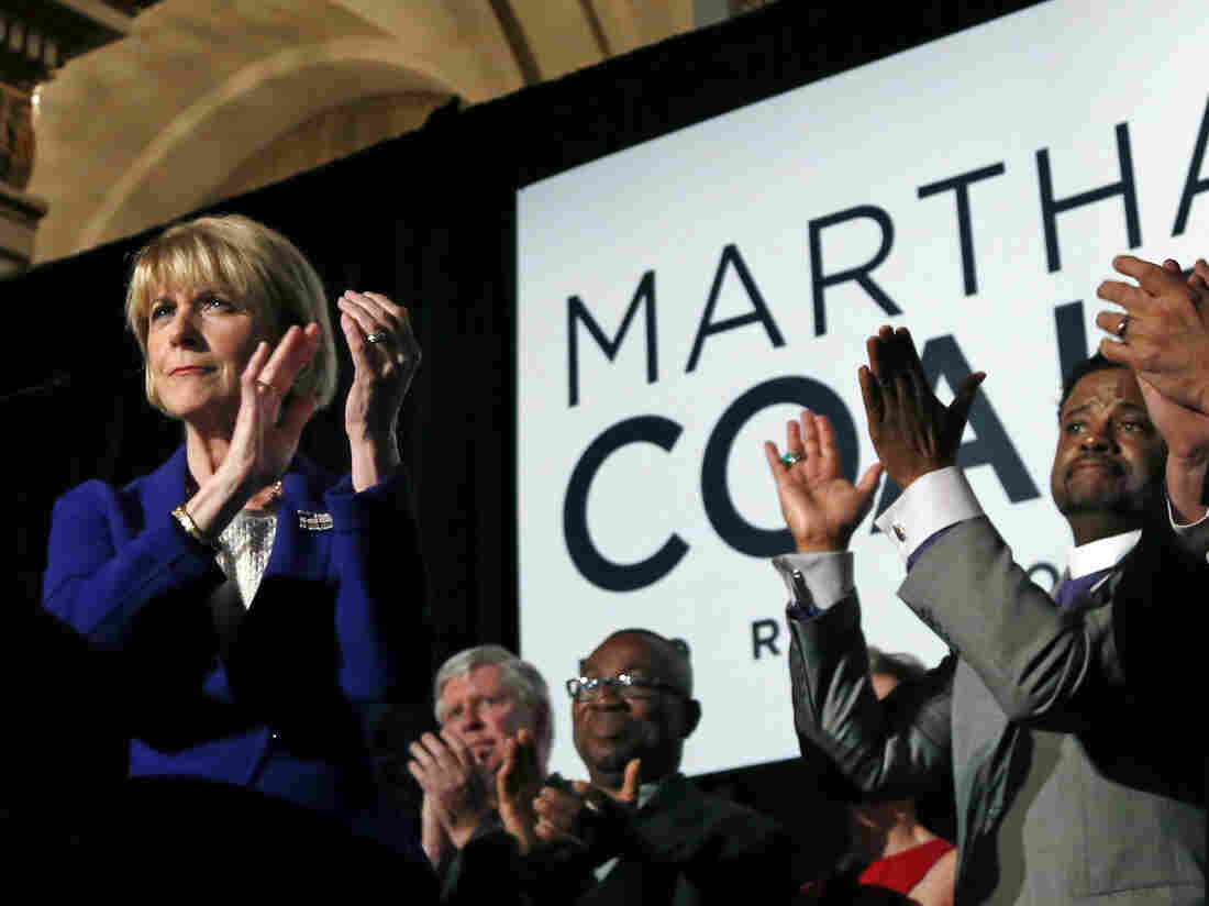 Massachusetts Democratic gubernatorial candidate Martha Coakley celebrates with supporters as she claims victory in the primary election Tuesday in Boston.