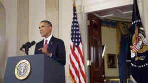 President Obama addresses the nation from Cross Hall in the White House on Wednesday. Opening a new military front in the Middle East, Obama authorized U.S. airstrikes inside Syria for the first time, along with expanded strikes in Iraq as part of a broad mission to root out violent Islamic State militants.