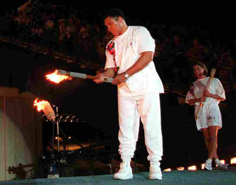 Muhammad Ali lights the Olympic flame during the 1996 Summer Olympic Games opening ceremony in Atlanta on July 19, 1996.