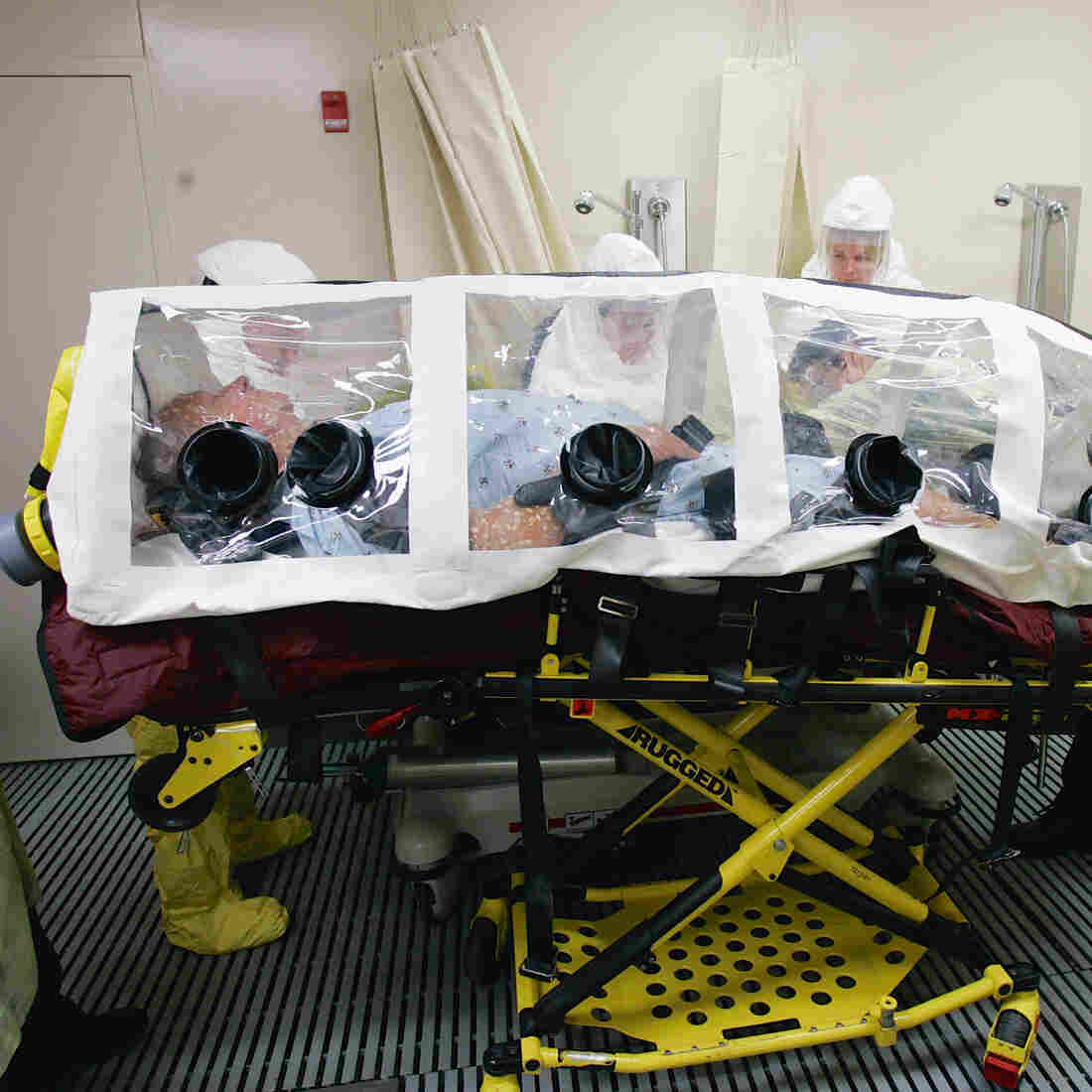 A mock patient is wheeled in an isolation pod during a drill at the biocontainment unit in the Nebraska Medical Center in Omaha.