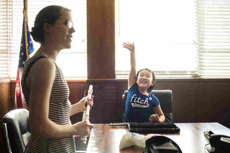 Student Cinee Hong eagerly waits for flute instructor Kathleen Ellingson's attention. Ellingson, a recent graduate of the University of Southern California, says when she's not teaching kids at Harmony Project, she's giving private lessons or working in the office of a local flute repair shop.