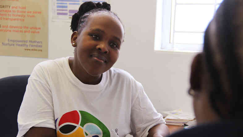 She's a mother talking to another mother — and both are HIV-positive. That's the mentoring role played by Phelokazi Tinzi, who works for  mothers2mothers in South Africa.