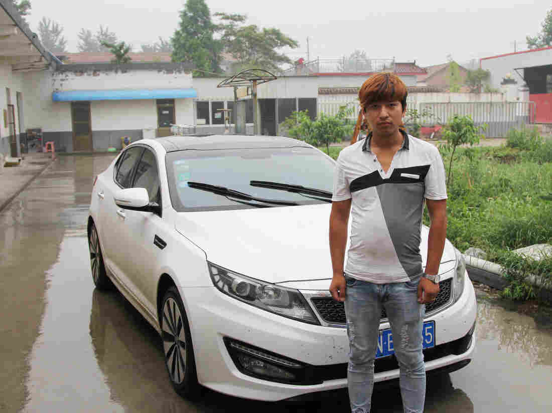 "Handsome Zhang — that's his real name in Mandarin --€"" runs a shipping company, one of many supporting businesses spawned by East Wind village's furniture industry. The shipping business helped Zhang, 25, buy this Kia sports car."