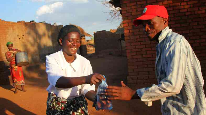 In Malawi, Biti Rose Nasoni used a CARE microsavings program to start a business selling doughnuts.