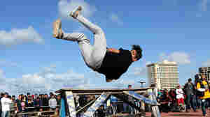 A Libyan youth displays his skills in parkour, an extreme sport, during a friendly competition in Tripoli
