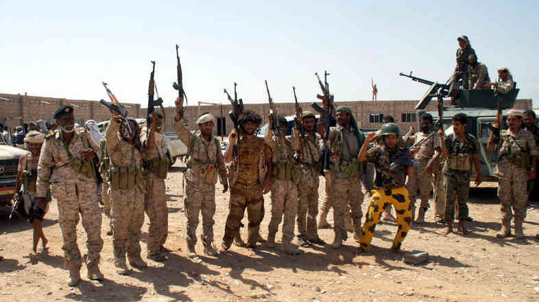 Yemeni soldiers hold up their weapons at an area seized from al-Qaida in the southeastern province of Shabwa, Yemen, on May 8. President Obama said Wednesday that U.S. strategy against the so-called Islamic State would be similar to how it targeted militants in Yemen and Somalia.