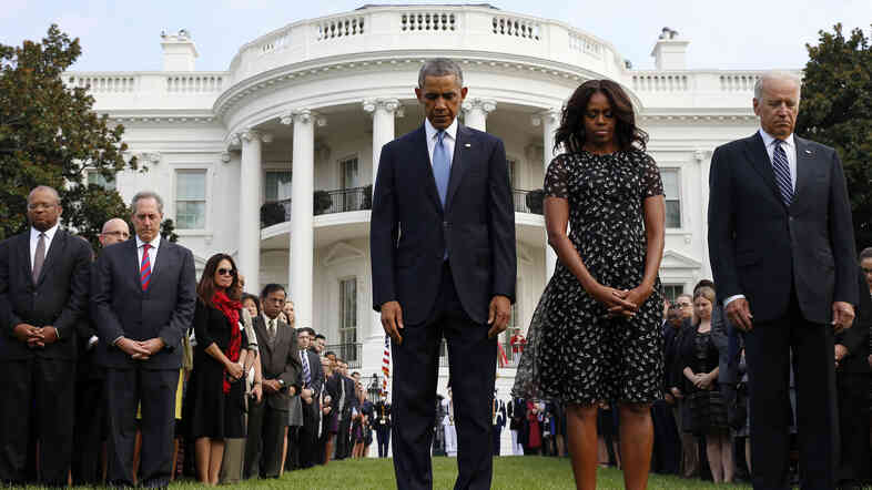 President Obama, first lady Michelle Obama, Vice President Joe Biden and others observe a moment of silence on the South Lawn of the White House on Thursday to mark the 13th anniversary of the Sept. 11 attacks.